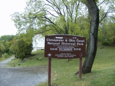 Entrance sign to Dam 5 site image. Click for full size.