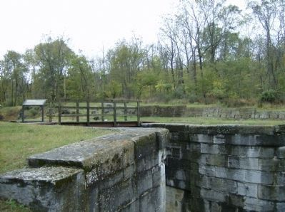 View from south-side of Lock #49 with the remains of a warehouse in the background image. Click for full size.