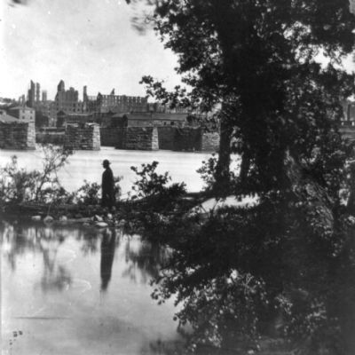 View of burned district and ruins of Mayo's bridge from across the James River. image. Click for full size.