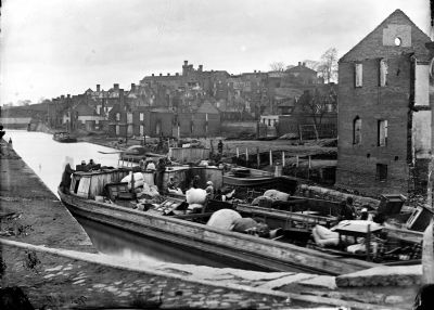 Richmond, Va. Barges with African Americans on the Canal; ruined buildings beyond. image. Click for full size.