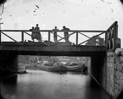 Richmond, Va. Bridge over the Canal; barges beyond. image. Click for full size.