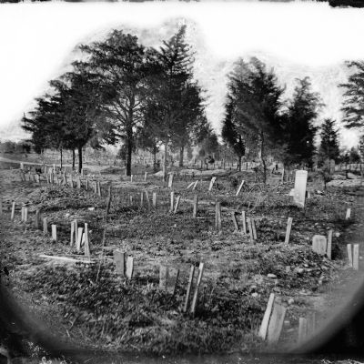 Graves of Confederate soldiers in Oakwood Cemetery, with board markers. image. Click for full size.