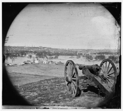 View of city from Belle Isle; gun in foreground. image. Click for full size.