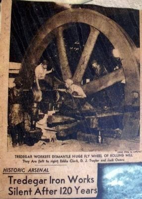 Workers dismantle the rolling mill flywheel image. Click for full size.