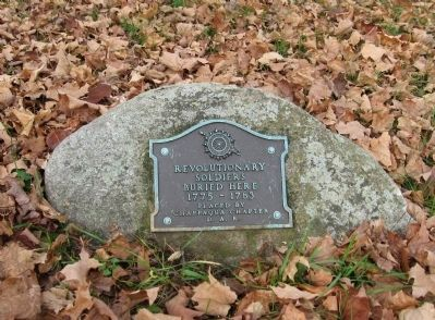 A small marker in the cemetery image. Click for full size.