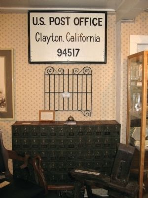Old Clayton Post Office Sign, Postboxes, Counter Bell and Grill image. Click for full size.