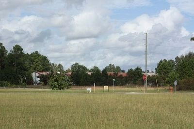 Trackside warehouses of yesteryear only visible signs of railroad days, seen today image. Click for full size.