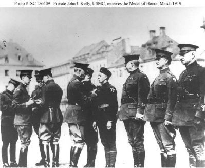 Private John J. Kelly, USMC receiving the Medal of Honor image. Click for full size.