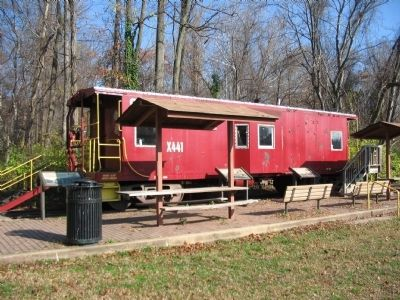 Three Markers in front of an Old Caboose image. Click for full size.