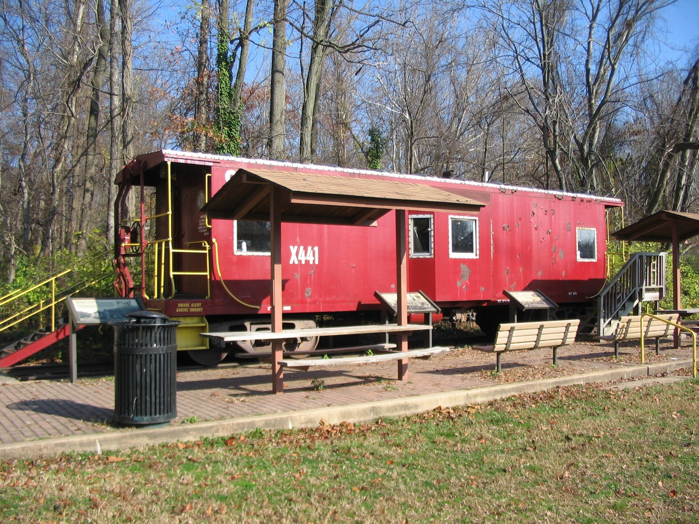 Three Markers in front of an Old Caboose