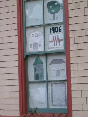 Student Quilt Art on Display in the Schoolhouse Window image. Click for full size.