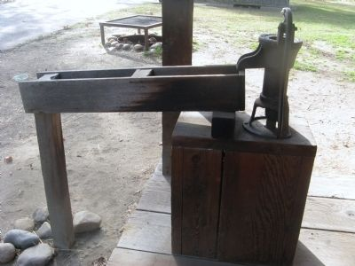 Water Pump on the Porch of the Cabin image. Click for full size.