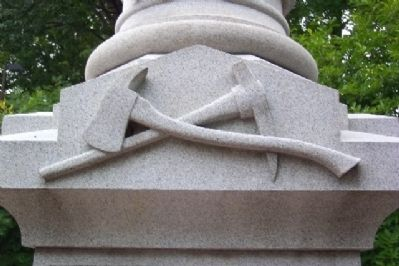 Axe and Mattock on Volunteer Firemen Memorial image. Click for full size.
