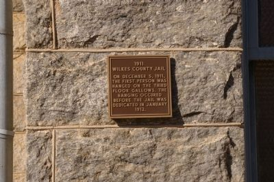 Plaque on Wilkes County Jail image. Click for full size.