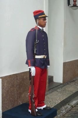 Sentry in ceremonial dress uniform at inner gateway to fort image. Click for full size.