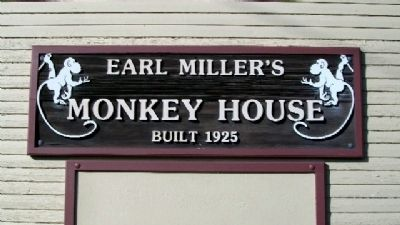 Sign on Earl Miller's Monkey House, built 1925 image. Click for full size.