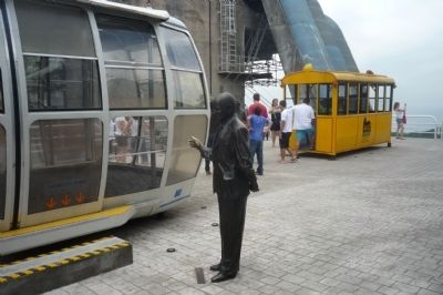Augusto Ferreira Ramos statue with display of vintage cable cars on Urca Mountain image. Click for full size.