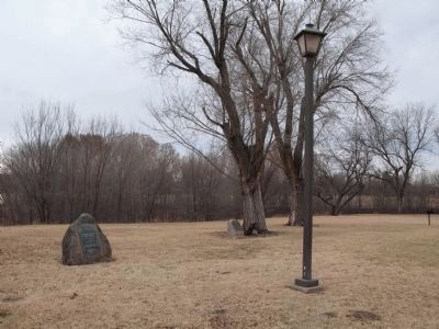 Historical marker (base of tree) and an additional marker in the area (left in photo) image. Click for full size.