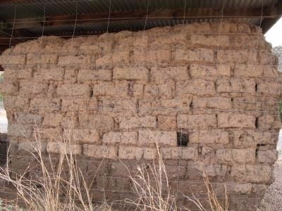 Closeup of wall showing adobe construction image. Click for full size.