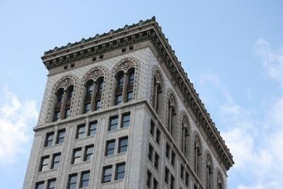 "The cornice work with the letter ""E"" along the top of the Empire Building. image. Click for full size."