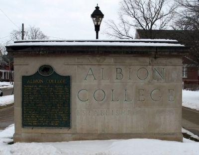 Albion College Marker on stone Albion College sign. image, Touch for more information