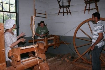 Hands on demonstration of a foot-pumped lathe image. Click for full size.
