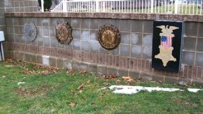Fraternal Order Emblems Near Memorial image. Click for full size.