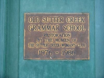 Plaque Mounted on the Green Front Door of Schoolhouse image. Click for full size.