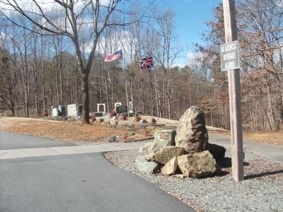 Flags Fly Above the Marker and Stones From the Dam at Clapp's Mill image. Click for full size.