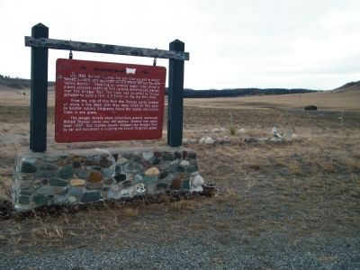 The Thomas Party Marker with gravesite in background image. Click for full size.