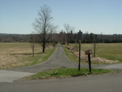 Riverside Farm driveway with marker in foreground. image. Click for full size.