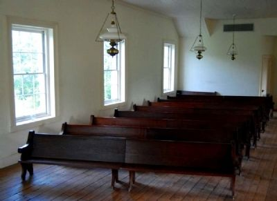 Row of Wooden Pews in Second Story Chapel image. Click for full size.