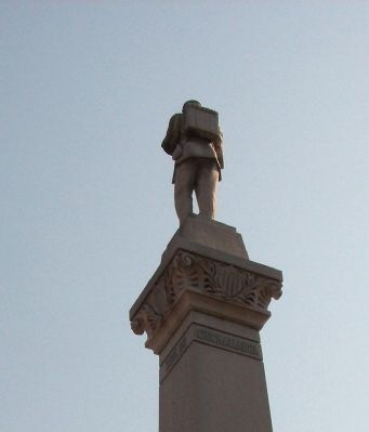 Obverse Left View - - Top Statue image. Click for full size.