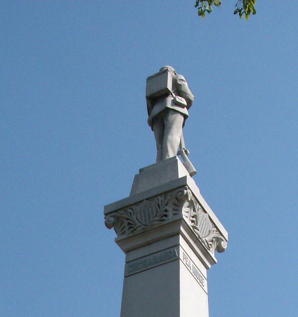 Obverse Right View - - Top Statue
