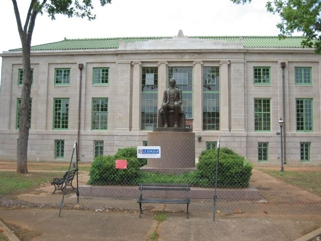 San Augustine County Courthouse and statue of Gov. James Henderson. image. Click for full size.