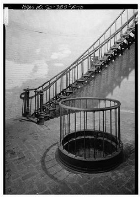 Hunting Island Light Station Interior, lamp mechanism weight pit, stairway image. Click for full size.