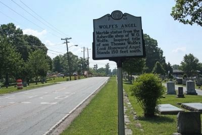 Wolfe's Angel Marker as seen along 6th Ave.(US 64), looking east image. Click for full size.