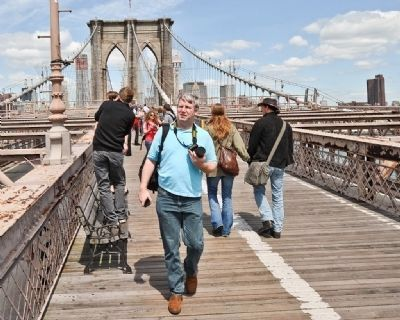 The Brooklyn Bridge has a pedestrian walkway that is popular with natives and tourists alike image. Click for full size.