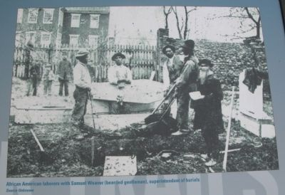 Photo of laborers with Samuel Weaver image. Click for full size.
