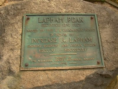 Close up of marker on boulder in front of Lapham Peak Marker image. Click for full size.