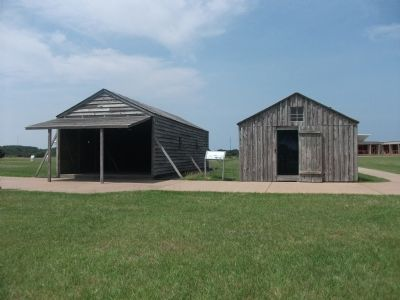 The Camp Marker and Replica Buildings image. Click for full size.