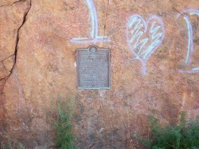 Ute Pass marker on cliff wall image. Click for full size.