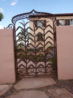 La Posada Entrance Walkway - A modern wrought-iron gate image. Click for full size.