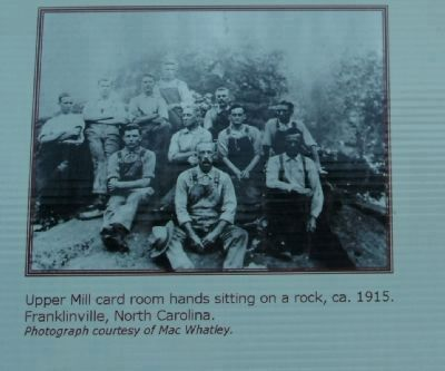 Upper Mill card room hands sitting on a rock, ca. 1915 image. Click for full size.