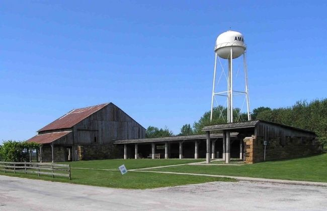 The 19th century Market Barn and the 20th century water tower in the village of Amana image. Click for full size.