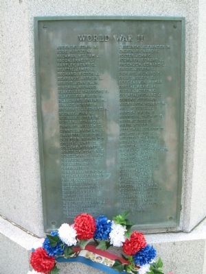 Left Plaque - World War II image. Click for full size.