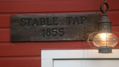 Closeup of sign over stable door image. Click for full size.