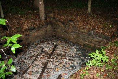 Stone wall surrounding one of the springs that emits white sulfur. image. Click for full size.