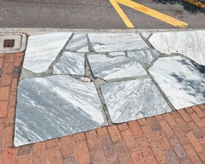 These marble stones are the remnants of Archie Ross' historic sidewalk image. Click for full size.