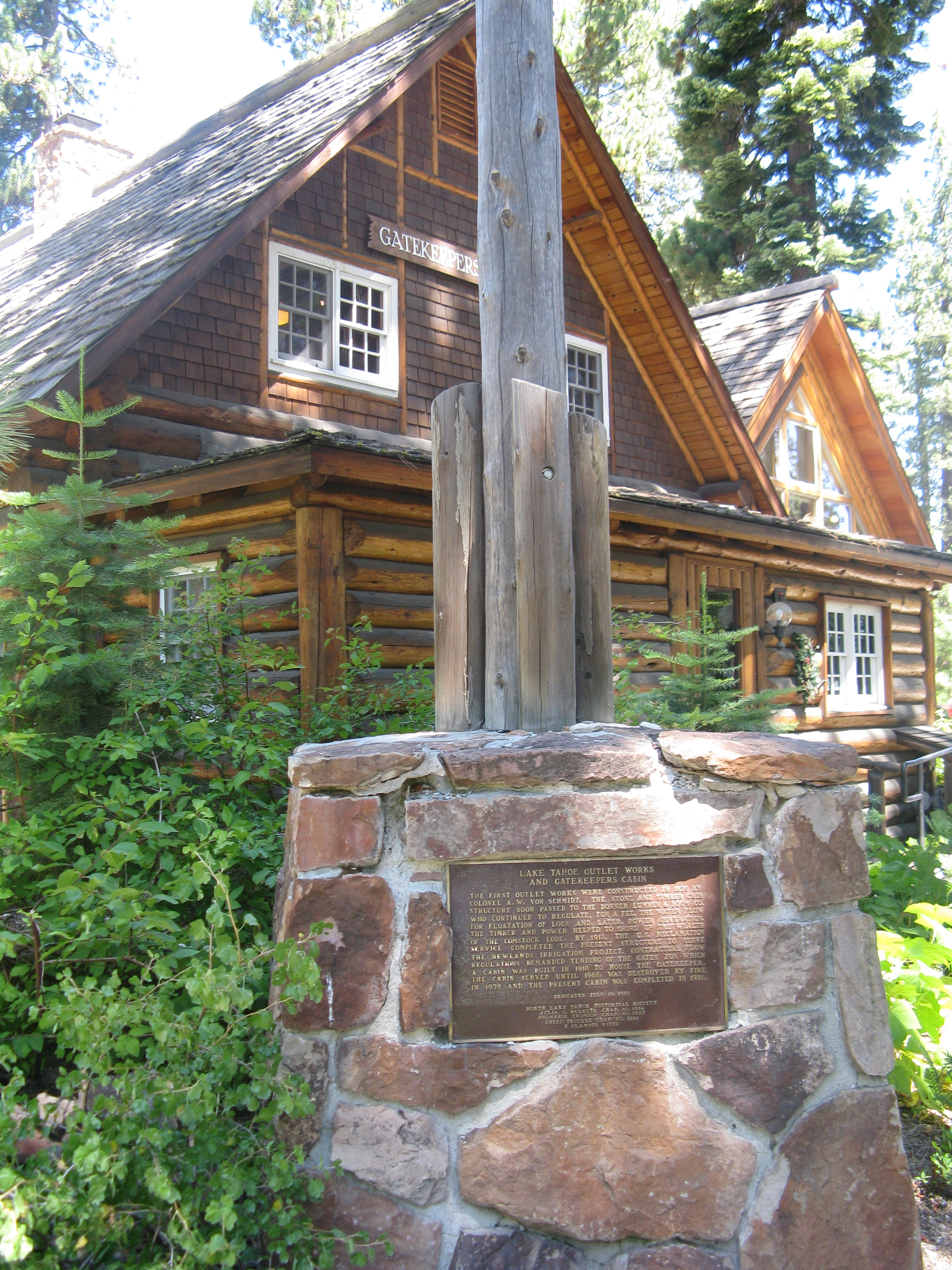 Lake Tahoe Outlet Works and Gatekeepers Cabin Marker With The Gatekeepers Museum in the Background